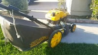 yellow and black Cub Cadet push mower Colton