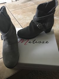 pair of gray suede chunky heel buckled ankle boots
