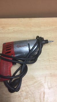 Red and silver Milwaukee power tool as is