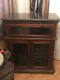 Wood cabinet with granite top and two wine coolers wine coolers not currently working Can have them repaired or take them out and use for more cabinet space Very nice cabinet Top area holds glasses and has light Mount Prospect, 60056