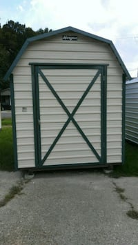 8x10 almond with green trim !steel building Baker, 70714