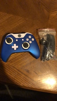 Blue and white scuf controller with accessorie bag.     Barely used.