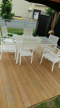 white wooden table with four chairs
