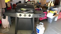 Gray and black gas grill comes with propane Tank!! Priced good !  Norco, 92860