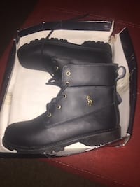 Pair of black leather combat boots with box