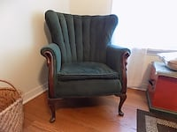 Antique wing back chair with wood carved trim. FOLEY