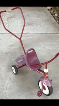 Radio Flyer metal/vinyl tricycle with pull/push bar with its basket