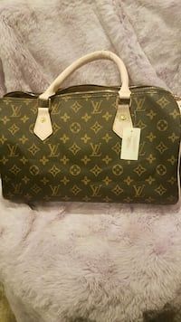 brown Louis Vuitton leather tote bag