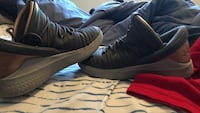 pair of grey basketball shoes