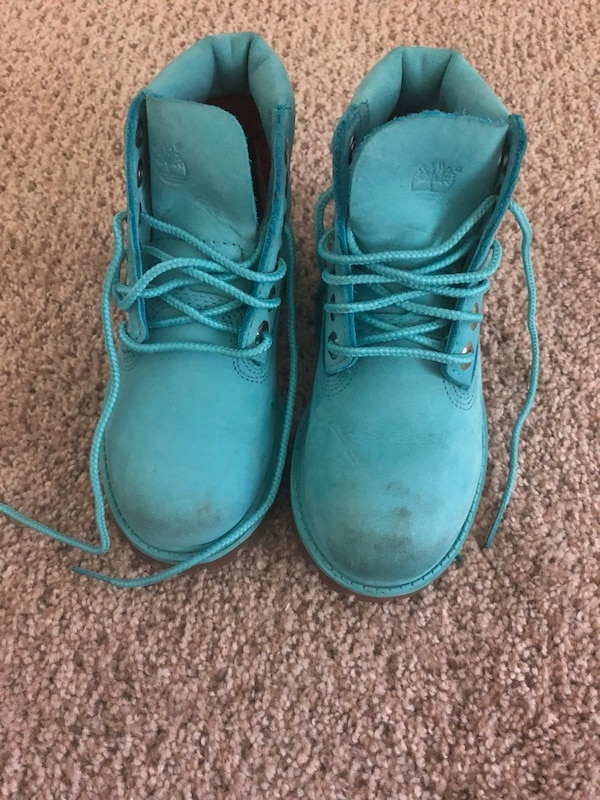pair of gray Timberland work boots