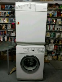 white front-load washer Laval, H7P 1C9