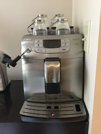 Stainless steel and black espresso machine
