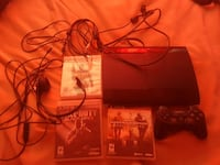 black Sony PS3 console with controller and games