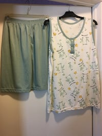 Never used!!!! White and green shirt and shorts pajama set size l and fit xl
