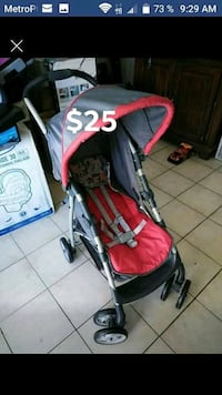baby's black and red stroller Las Vegas, 89110