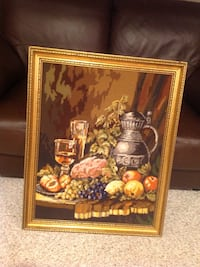 Needlepoint in gold frame