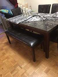 rectangular brown wooden dining table Toronto, M9V 4A4