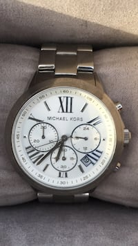 round white Michael Kors chronograph watch with silver link bracelet