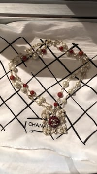 white and red Chanel pearl necklace