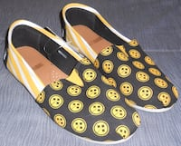 pair of yellow-and-black slip-on shoes