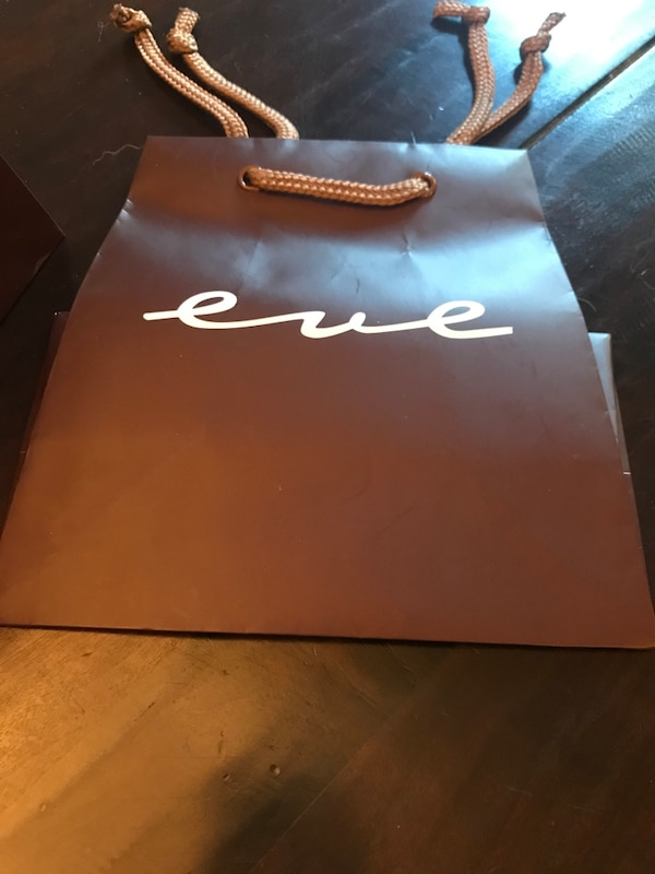 Brown Retail Bags With Eve Logo On Them Whole Lot Of C1700 For