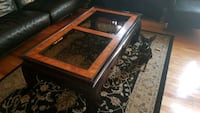 brown wooden framed glass top coffee table Sainte-Marthe-sur-le-Lac, J0N