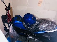 Blue and black sports bike
