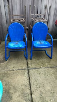 Two blue heavy outdoor armchairs