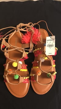 Pair of brown leather strappy Express sandals
