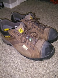 pair of black-and-brown Caterpillar hiking shoes