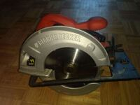 gray and red Black & Decker circular saw