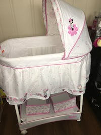 white and pink Minnie Mouse bassinet