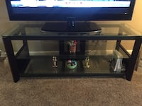 Black glass-top tv stand