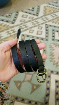 gold-colored buckle with black leather belt