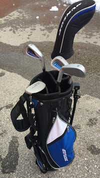 White, blue, and black golf club and bag set