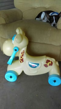 toddler's yellow, beige, red, and blue ride on toy Warner Robins, 31088