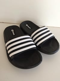 Pair of black transit slide sandals Brossard, J4Y 3E1