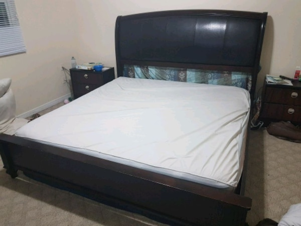 white mattress and black wooden king size bed b6af951d-ec78-4420-a945-39b37e62c98f