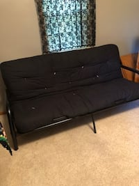 Nice black futon with black metal frame.  Would do someone nicely for college. HASTINGS