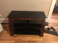 brown wood base black glass top TV stand