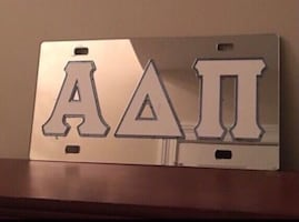 ADPi mirrored license plate