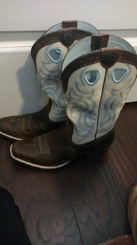 pair of white-and-brown leather cowboy boots