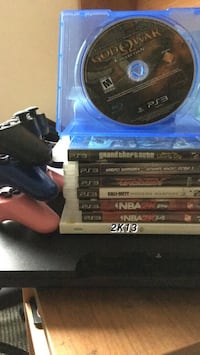 black Sony PS4 console with controller and game cases Schenectady, 12305