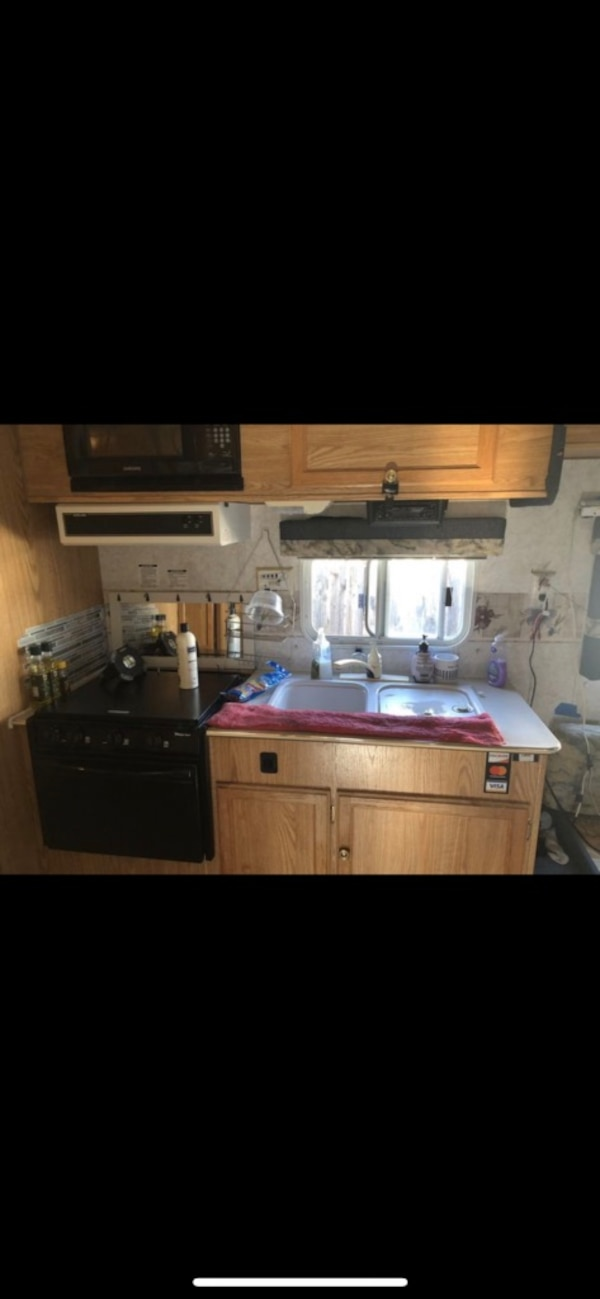 I have a great trailer for rent supper clean inside it's pop out 3 bed    Everything work like new   The rent for the land $800 so I will take $400  for