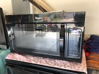 black Whirlpool overt-the-cabinet microwave Kissimmee, 34743