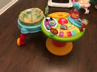 baby's yellow, green, and blue learning toy set