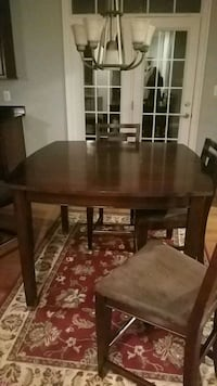 rectangular brown wooden table with four chairs dining set 23 km