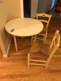 round white wooden table with four chairs dining set East Providence, 02914
