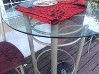 Bar style glass table two chairs and still in great shape  Calgary, T2A 0G2