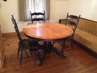 round beige and black wooden pedestal table with three chairs with 4 chairs Somerville, 02145